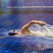 The young sports swimmer in pool — Stockfoto