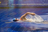 The young sports swimmer in pool — Stok fotoğraf