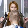 Pretty woman hairdresser cuts client — Stock Photo #2583589