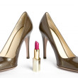 Stock Photo: Shoes on high heel and lipstick