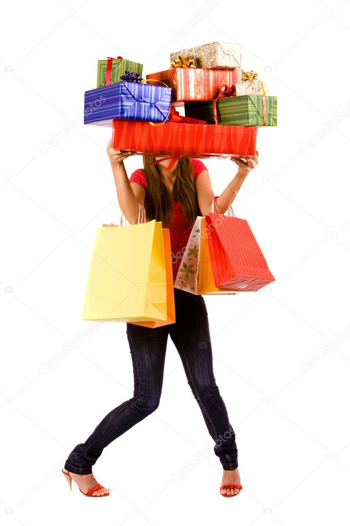 Attractive shopping woman holding many gift boxes and bags. — Stock Photo #1738916