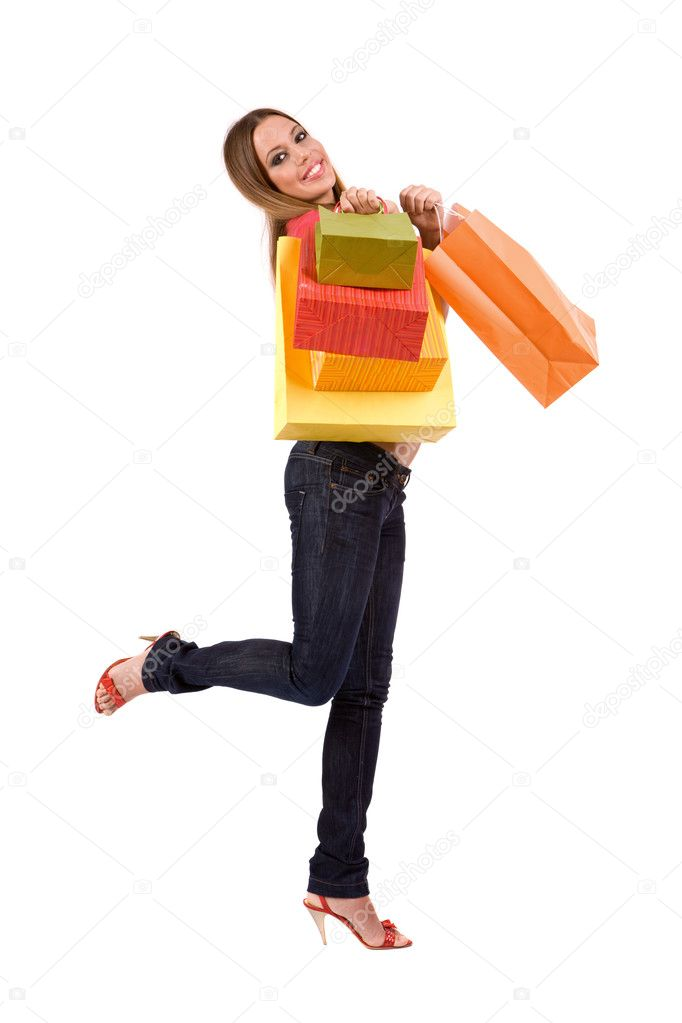Attractive shopping woman holding many gift boxes and bags. — Stock Photo #1780162