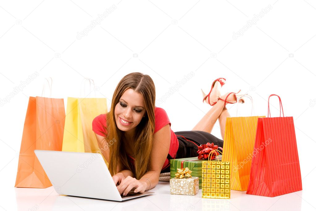 Beautiful young woman shopping over internet.  Lizenzfreies Foto #1807192
