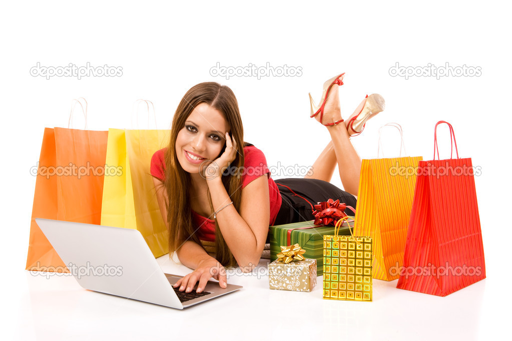 Beautiful young woman shopping over internet. — Stock Photo #1807641
