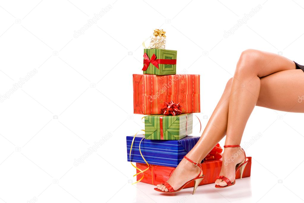 Attractive woman legs with many colorful gift boxes.  Stock Photo #1811356