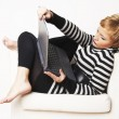 Nice blondgirl sitting on the chair - Stock Photo