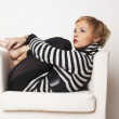 Nice blondgirl on the chair — Stock Photo
