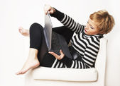 Nice blondgirl sitting on the chair — Stock Photo