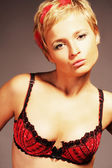 Sexy blond in red lingerie — Stock Photo
