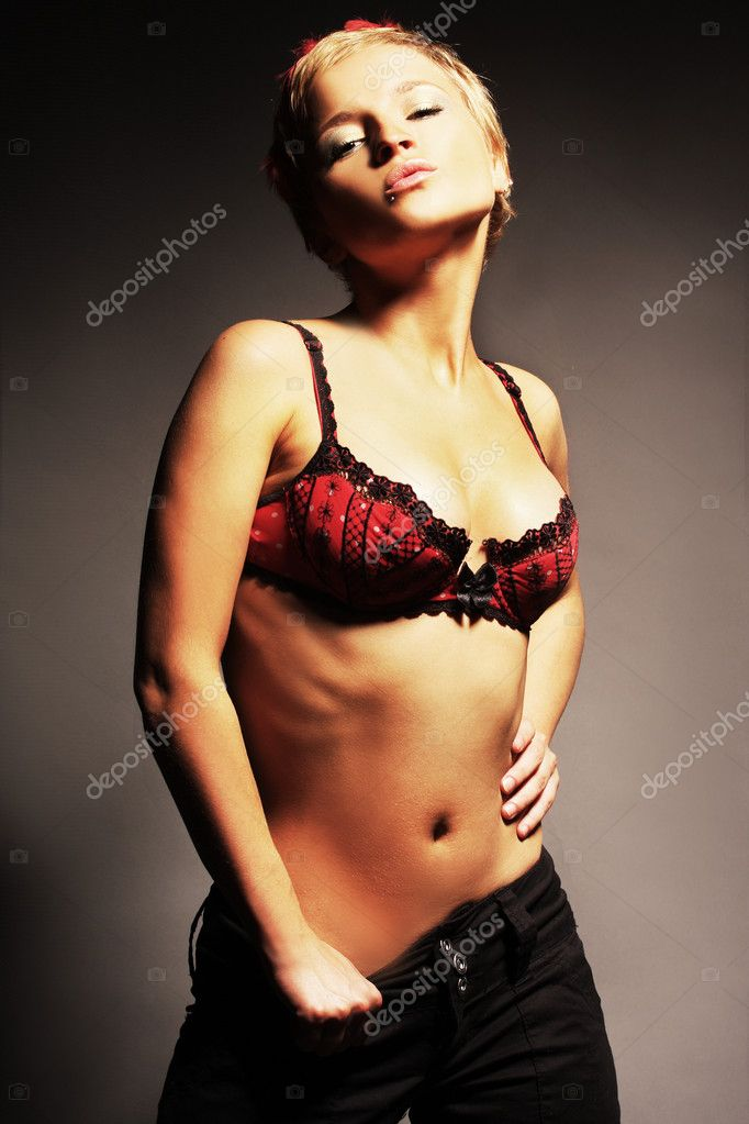 Sexy blond standing in red bra — Stock Photo #1797177