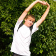 Young man does warm-up — Stockfoto