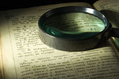 Old bible page and lens — Foto de Stock