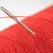 Red bobbin and needle — Stock Photo #2450161