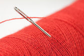 Red bobbin and needle — Stock Photo