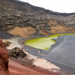 Volcanic crater as a beach - Stock Photo