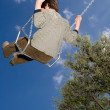 Stock Photo: Kid in swing