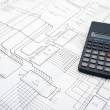 Table with schematics and calculator - Stockfoto