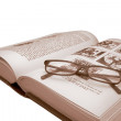 Old book and glasses on white — Stock Photo