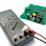 Multimeter and printer circuit board — Stock Photo