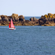 Foto de Stock  : Red sailboat in Atlantic Ocean