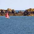 Red sailboat in the Atlantic Ocean — Stock Photo #1809610