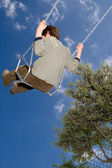 Kid in a swing — Stock Photo