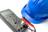 Helmet and multimeter isolated — Stock Photo