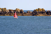 Red sailboat in the Atlantic Ocean — Stok fotoğraf