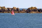 Red sailboat in the Atlantic Ocean — Stock Photo