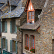 Old medieval houses in Mont Saint Michel - Stock Photo