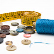 Measuring tape and thread bobin - Stock Photo