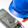 Helmet and multimeter — Stock Photo