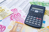 Euro banknotes and calculator — Stock Photo