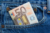 50 euro note in a blue jeans pocket — Stock Photo