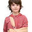 Boy with sling on broken arm - Stok fotoraf