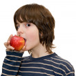 Kid eating an apple on white background — Stock Photo #2490197