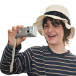 Happy kid taking a photo — Stock Photo #2490223