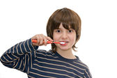 Boy brushing teeth, isolated on white — Stok fotoğraf