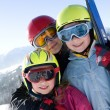 Stock Photo: Young smiling girls with ski