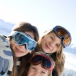 Young smiling girls on ski camp — Stock Photo
