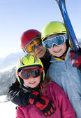 Young smiling girls with ski — Stok fotoğraf