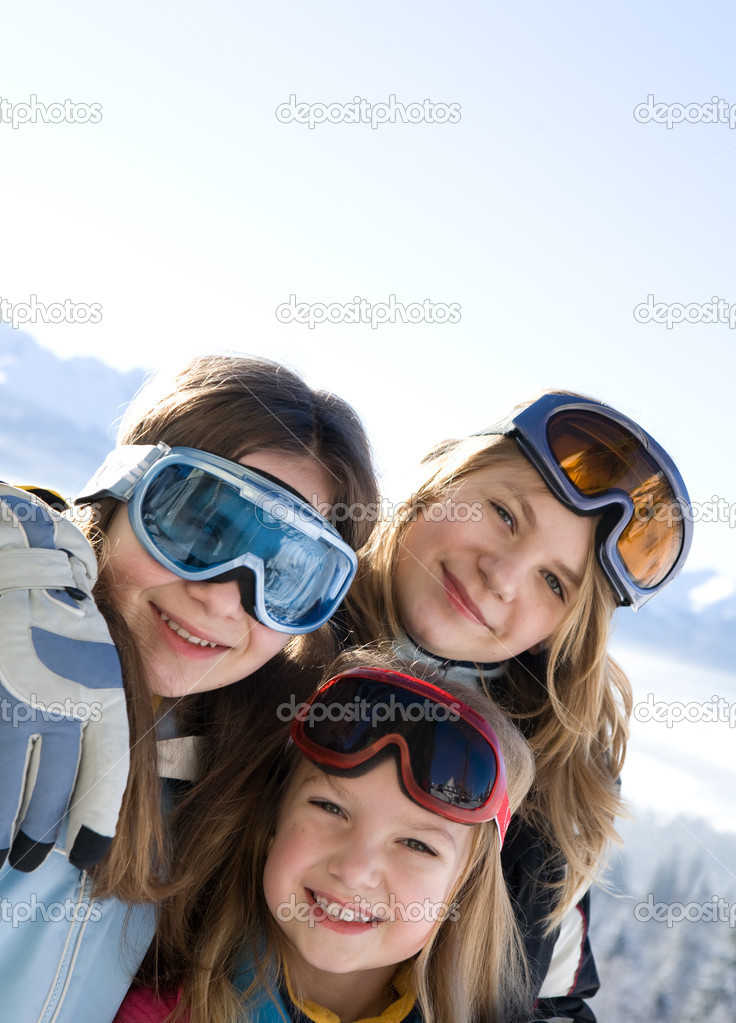Young smiling girls with ski goggles. Mountains in background. — Stock Photo #1858926