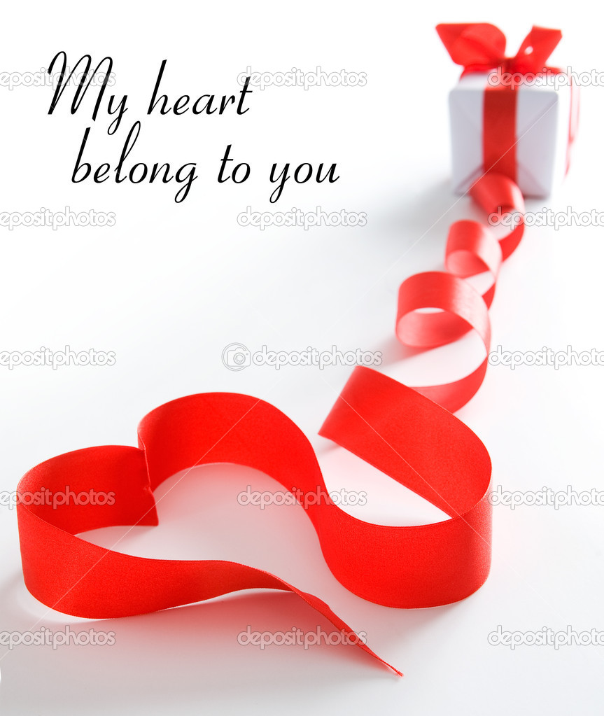 Stylized valentine heart made from red bow. Space for text isolated on solid color  Stockfoto #1858956