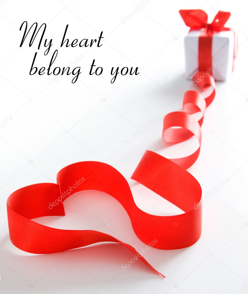 Stylized valentine heart made from red bow. Space for text isolated on solid color — Photo #1858956