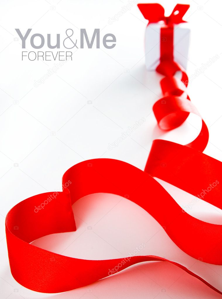 Red heart made of ribbon. White gift box in background. Space for text isolated on white.   Stock Photo #1874342