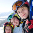 Young smiling girls with ski - Stok fotoğraf