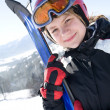 Stock Photo: Happy girl with ski