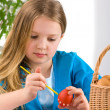 Girl painting easter egg — Foto Stock