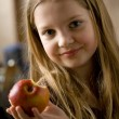 Girl with apple — Stockfoto
