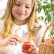 Little girl painting easter egg — Stock Photo